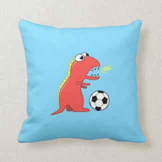 Dinosaurio divertido del dibujo animado que juega  almohada