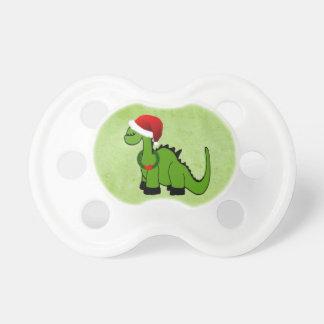 Dinosaurio en el gorra de Santa Chupete De Bebe