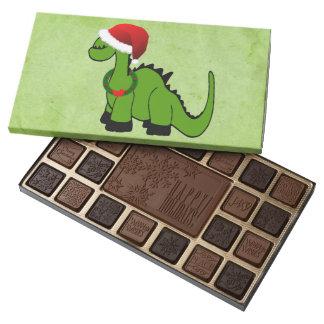 Dinosaurio verde en un gorra de Santa para el Caja De Bombones Variados Con 45 Piezas