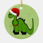 Dinosaurio verde en un gorra de Santa para el Adorno Redondo De Cerámica