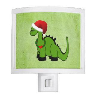 Dinosaurio verde en un gorra de Santa para el Lámparas De Noche