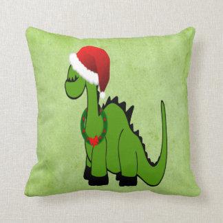 Dinosaurio verde en un gorra de Santa para el navi Almohadas