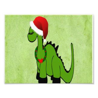 Dinosaurio verde en un gorra de Santa para el navi Fotografías