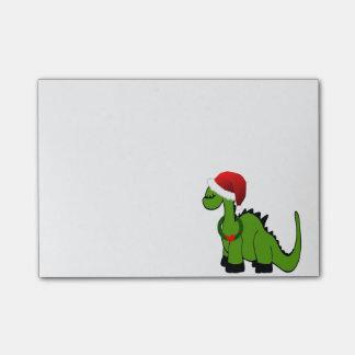 Dinosaurio verde en un gorra de Santa para el Notas Post-it®