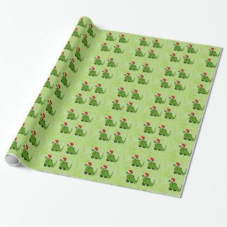 Dinosaurio verde en un gorra de Santa para el Papel De Regalo