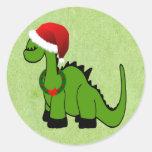 Dinosaurio verde en un gorra de Santa para el Pegatina Redonda