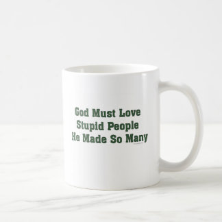 Dios debe amar a gente estúpida tazas de café