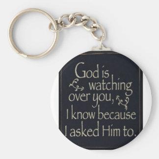 Dios está vigilando usted llavero