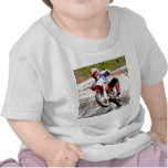 Dirt Bike Wheeling in the Mud in Color Shirts