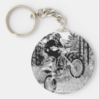 Dirt bike wheeling in the woods keychains