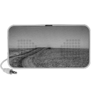 Dirt road over frosted pasture notebook speakers