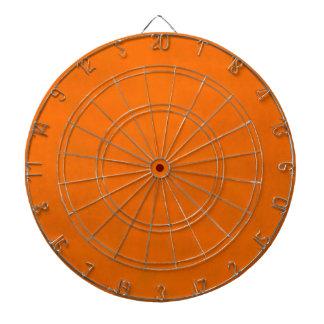 Dirty Orange Dartboard With Darts