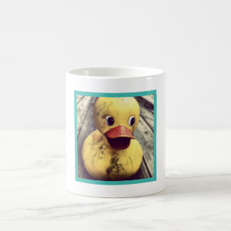 Dirty Rubber Duck Sitting on a Wooden Deck Coffee Mug