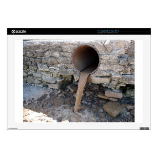 Dirty water flows from a brown rusty sewer pipes decal for laptop