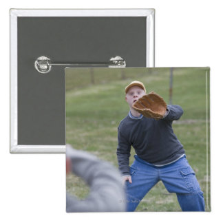 Disabled man playing baseball with his son button