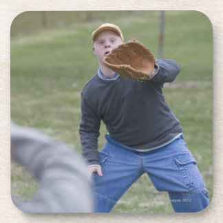 Disabled man playing baseball with his son beverage coasters