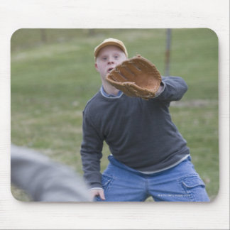 Disabled man playing baseball with his son mouse pad