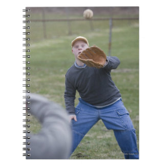 Disabled man playing baseball with his son spiral notebook