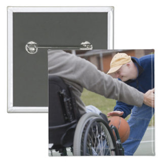 Disabled man playing basketball with his son 2 inch square button