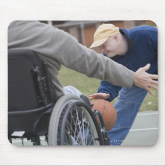 Disabled man playing basketball with his son mouse pad