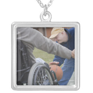 Disabled man playing basketball with his son square pendant necklace