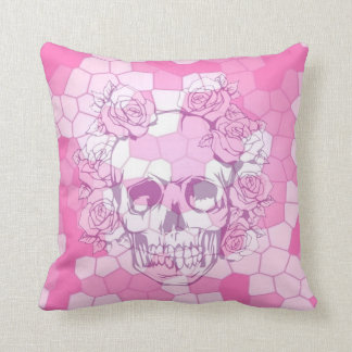 Disappearing skull with roses on pink cushion