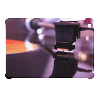 Disco de vinilo anaranjado con el fondo púrpura fr