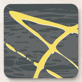 Diseño abstracto en gris y amarillo posavasos