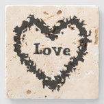 Diseño abstracto negro artístico del corazón del posavasos de piedra