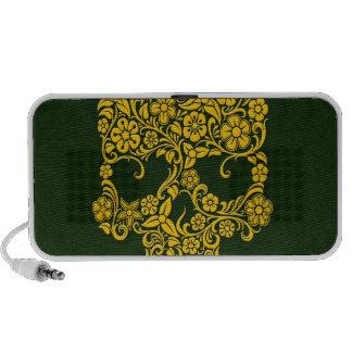 Diseño amarillo del cráneo de las flores y de las laptop altavoces