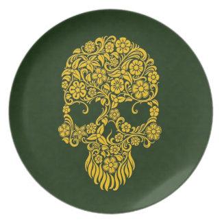 Diseño amarillo del cráneo de las flores y de las plato de comida