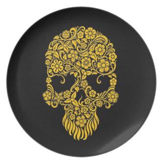 Diseño amarillo del cráneo de las flores y de las platos de comidas