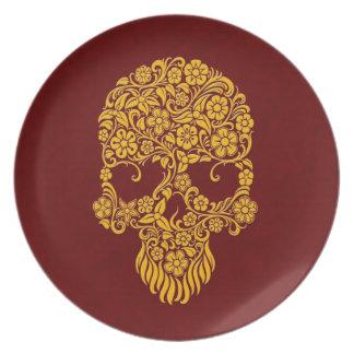 Diseño amarillo del cráneo de las flores y de las plato