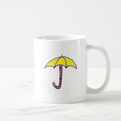 Diseño amarillo del paraguas taza