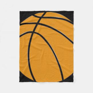 Diseño anaranjado del baloncesto con el fondo manta polar