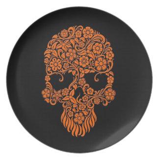 Diseño anaranjado del cráneo de las flores y de la plato para fiesta