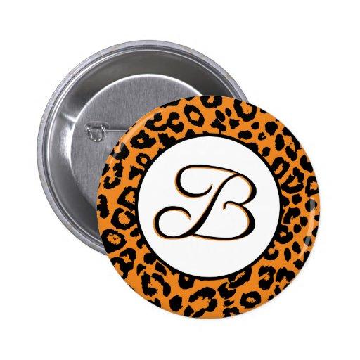 Diseño anaranjado del leopardo con el monograma de pin