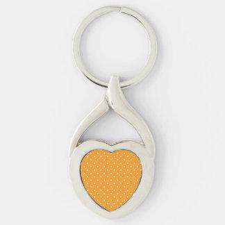 Diseño anaranjado del lunar llavero plateado en forma de corazón