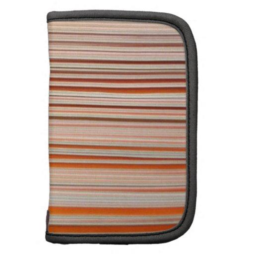Diseño anaranjado y blanco de la raya ondulado planificadores