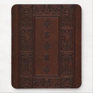 Diseño antiguo del libro grabado en relieve del mousepads