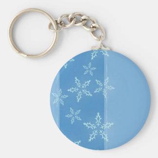 Diseño azul del copo de nieve llavero