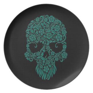 Diseño azul del cráneo de las flores y de las vide platos