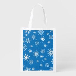 Diseño azul del navidad del copo de nieve bolsas de la compra