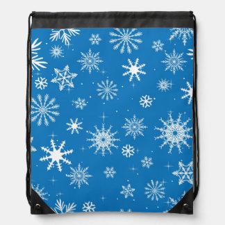 Diseño azul del navidad del copo de nieve mochilas