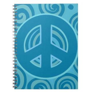 Diseño azul del signo de la paz libreta