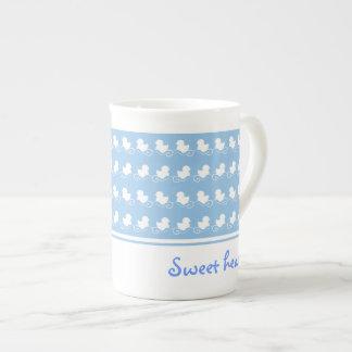 diseño azul dulce con la fila de los patos blancos taza de té
