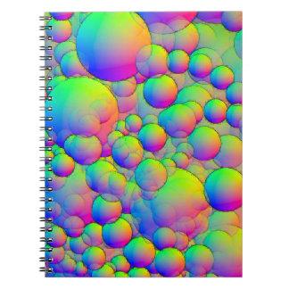 diseño coloreado multi brillante del círculo del libro de apuntes con espiral