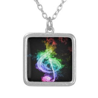 Diseño colorido de la nota musical colgante cuadrado