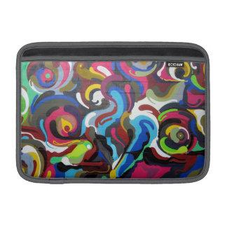 Diseño colorido de la pintada de los remolinos en fundas MacBook