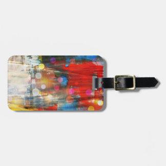 Diseño colorido de las salpicaduras de la pintura  etiqueta para maleta